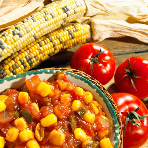High angle view of a bowl of salsa with tomatoes and corn : Stock Photo