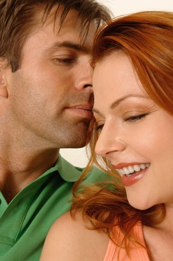 Portrait of an attractive couple snuggling. : Stock Photo