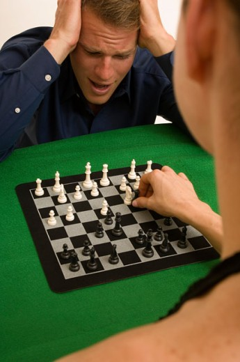 Stock Photo: 1624R-1674 Portrait of a man and woman playing chess together.
