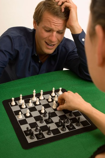 Stock Photo: 1624R-1675 Portrait of a man and woman playing chess together.