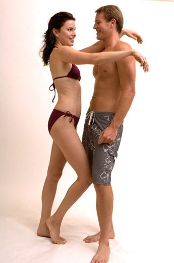 Stock Photo: 1624R-1747 Portrait of a couple flirting with each other in bathing suits.