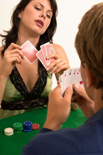 Portrait of a man and woman playing poker together. : Stock Photo