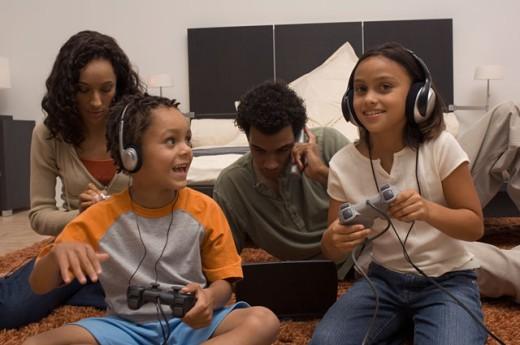Portrait of a family enjoying technology : Stock Photo
