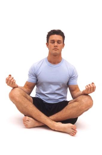 Stock Photo: 1624R-2786 Portrait of an attractive Caucasian male doing yoga.