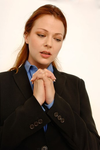 Portrait of a business woman praying. : Stock Photo