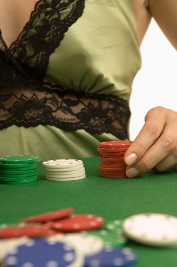 Portrait of a woman's torso playing poker. : Stock Photo