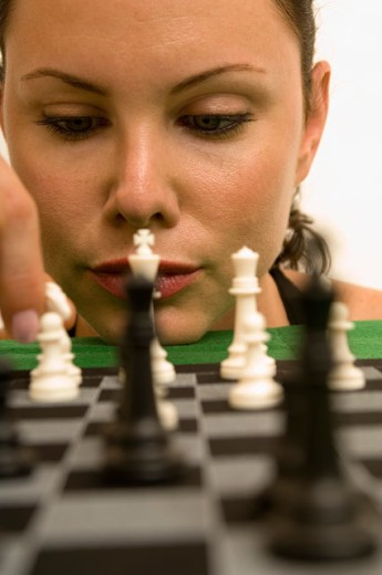 Portrait of a woman playing chess. : Stock Photo