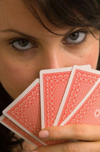 Stock Photo: 1624R-3366 Extreme closeup of a woman playing poker.