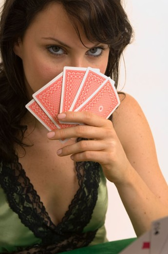 Stock Photo: 1624R-3367 Extreme closeup of a woman playing poker.