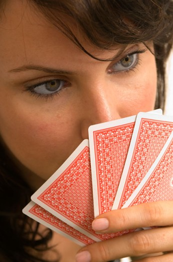 Stock Photo: 1624R-3368 Extreme closeup of a woman playing poker.