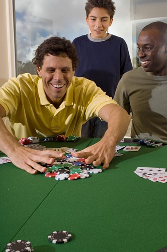 Portrait of men playing cards : Stock Photo