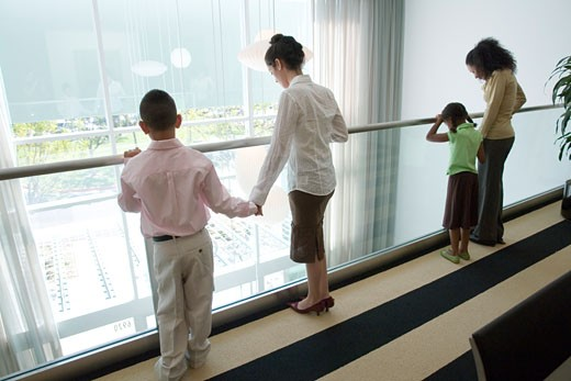 Women and children looking over the handrail : Stock Photo