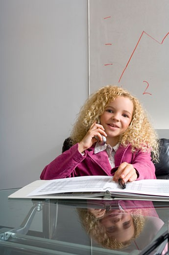 Junior businesswoman talking on cell phone : Stock Photo
