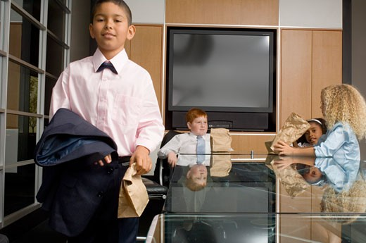 Portrait of young Hispanic boy in office meeting : Stock Photo