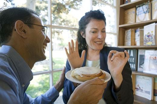 Couple enjoying a pastry : Stock Photo