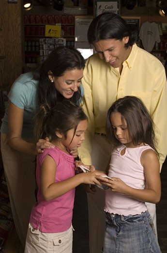 Family looking at books : Stock Photo