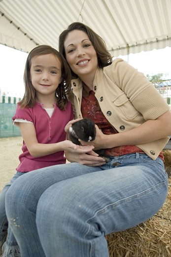 Mother and daughter with bunny : Stock Photo
