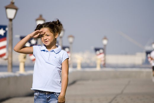 Portrait of young saluting : Stock Photo