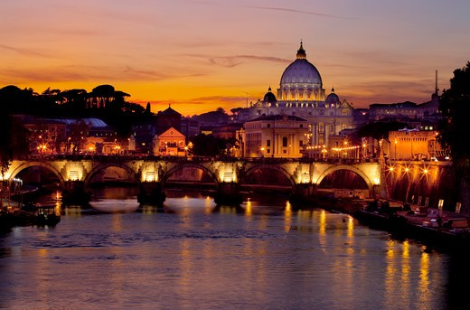 Italy, Rome, Ponte Sant Angelo, sunset from bridge across Tiber river, St. Peter's Basilica in background : Stock Photo