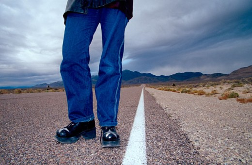 Stock Photo: 1626-1566 The Feet of a Hitchhiker