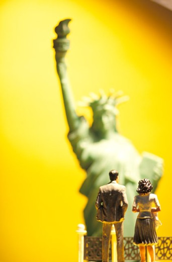 Stock Photo: 1626-2065 Toy People In Front of Toy Statue of Liberty
