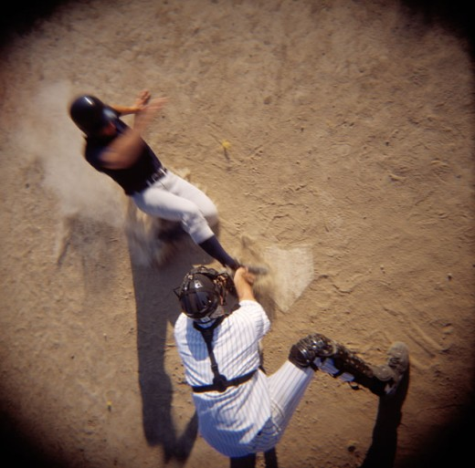 Stock Photo: 1626-2134 Baseball Player Sliding Into Home Plate