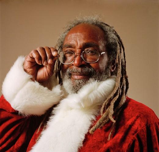 African American Santa Claus Adjusting His Glasses : Stock Photo