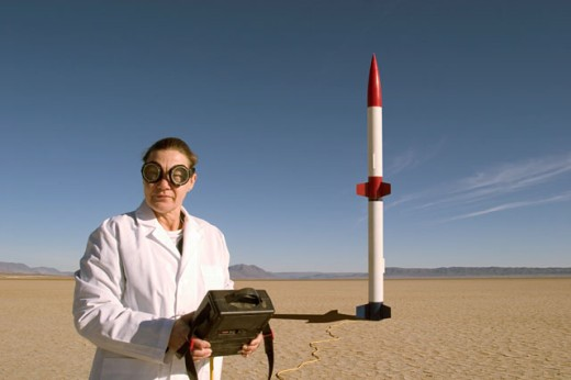 Stock Photo: 1626-2209 Woman Launching A Rocket In The Desert