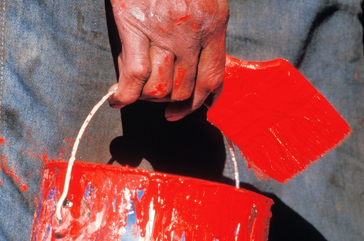 Stock Photo: 1626R-10530 Close up of man carrying paint and paintbrush