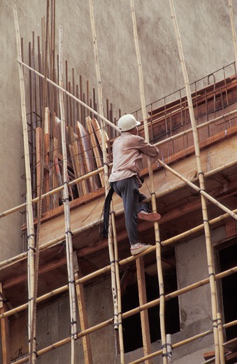 Construction worker on wooden scaffold : Stock Photo