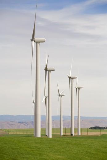 Solar powered wind turbines in remote field : Stock Photo