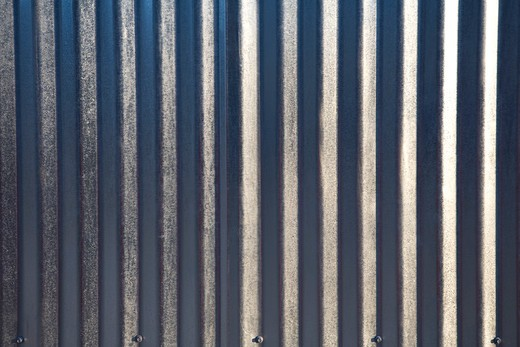 Close up of silver corrugated metal sheet : Stock Photo