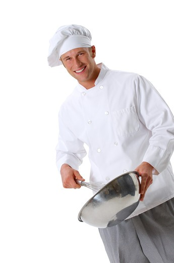 Chef in chef's whites and toque holding whisk and bowl mixing batter : Stock Photo