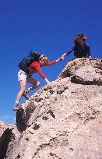 Stock Photo: 1626R-11760 Man and Woman Rock Climbing