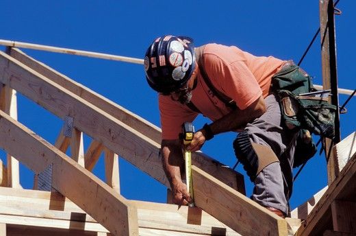 Stock Photo: 1626R-11937 Carpenter Working on Roof