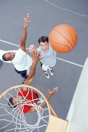 Stock Photo: 1626R-11992 Men Playing Basketball