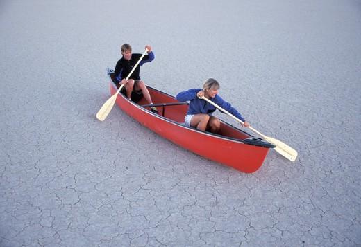 People Pretending to Canoe on Dry Land : Stock Photo