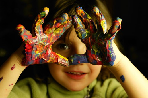 Little Girl Fingerpainting and Smiling : Stock Photo