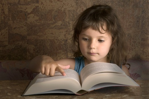 Stock Photo: 1626R-14806 Young Girl Reading From A Big Book