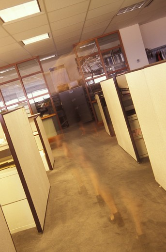 Stock Photo: 1626R-14979 Female Phantom Walking Through An Empty Office