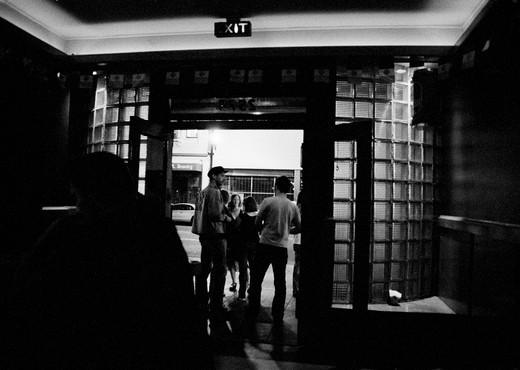 Standing In The Doorway Of A Neighborhood Bar : Stock Photo