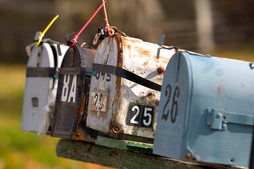 Stock Photo: 1626R-15410 Rusty Mailboxes On An Old Country Road