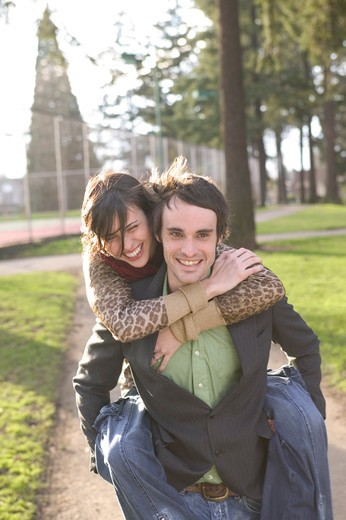 Piggyback Ride In The Park : Stock Photo