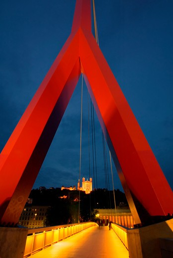 Walking Along A Bridge Through A Red Triangular Arch In France : Stock Photo