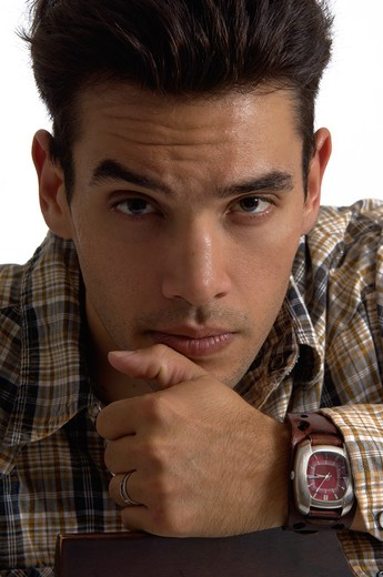Stock Photo: 1626R-17126 Young Man Looking Serious