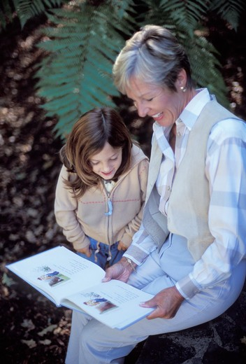 Older Woman and Young Girl Reading : Stock Photo