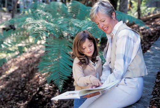 Stock Photo: 1626R-17943 Older Woman and Young Girl Reading