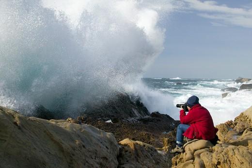 Stock Photo: 1626R-17978 Photographer Shooting Ocean Spray