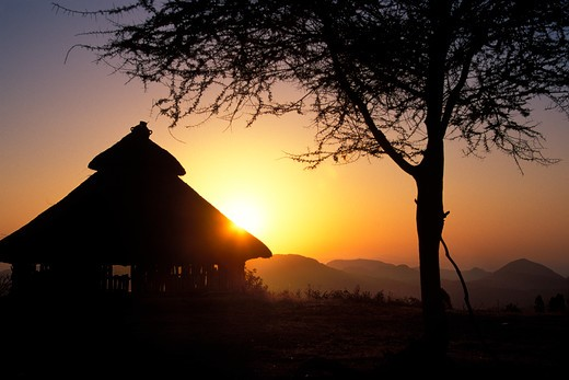 Stock Photo: 1626R-18628 Sunset behind Konso Hut in Omo Region of Ethiopia Africa