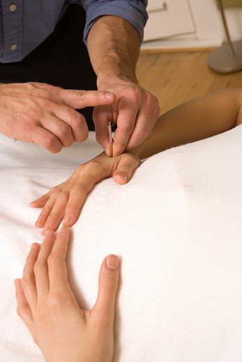 Stock Photo: 1626R-18687 Doctor Placing Acupuncture Needle